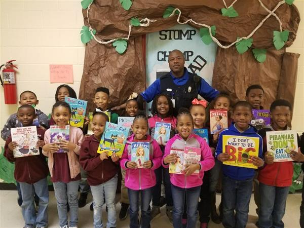 Officer Ford rewarded some students with books from the book fair for making honor roll!